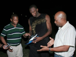 Usain Bolt signing shoes